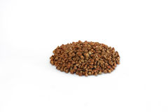 Raw buckwheat handful isolated. On a white background Royalty Free Stock Photos