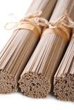 Raw buckwheat soba noodles macro  isolated vertical Stock Photography