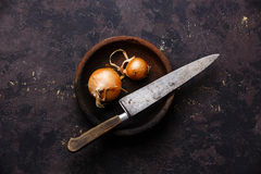 Raw bulb onion and Kitchen Knife Royalty Free Stock Image