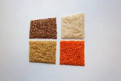 Raw bulgur, buckwheat, basmati rice and red lentils on white background royalty free stock images