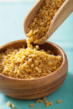 Raw bulgur in scoop and bowl Royalty Free Stock Image
