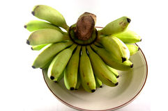 Raw bunch bananas on white. Background Royalty Free Stock Photo