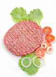 Raw burger closeup on a white background. Raw burger with fresh ingredients Royalty Free Stock Photos