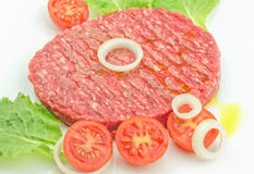 Raw burger closeup on a white plate. Raw burger with fresh ingredients Stock Image