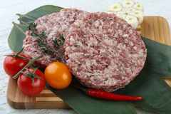 Raw burger cutlet Stock Photography