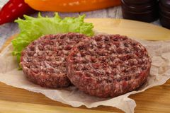 Raw burger cutlet. Ready for grill royalty free stock images