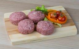Raw burger cutlet Stock Photos