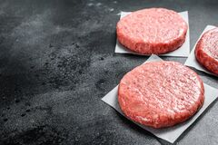 Free Raw Burger Patties, Ground Beef Meat. Black Background. Top View. Copy Space Royalty Free Stock Photos - 190991878