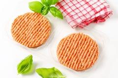 Raw burger patties. In plastic packaging Stock Image
