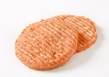 Raw burger patties Stock Images
