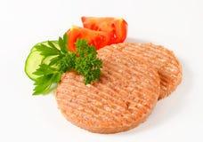 Raw burger patties Royalty Free Stock Photography