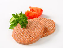 Raw burger patties Royalty Free Stock Images