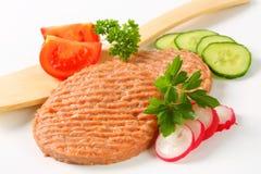 Raw burger patties Stock Photos