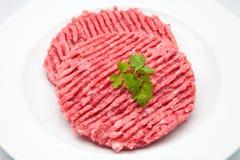 Raw burgers Stock Photography
