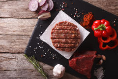 Raw burgers cutlets with the ingredients. horizontal top view Stock Image