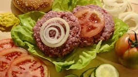 Raw burgers stock video footage