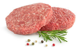 Raw burgers. Two raw hamburger, rosemary and pepper on white background Stock Photography