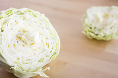 Raw cabbage sliced on wood table Stock Images