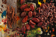 Raw cacao nibs, shredded chocolate and cocoa beans. On vintage painted background royalty free stock photos