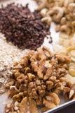 Raw cacao, sliced almonds, walnut, cashew. Assortments of Nuts: raw cacao, sliced almonds, walnut, cashew Stock Photos
