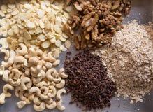 Raw cacao, sliced almonds, walnut, cashew. Assortments of Nuts: raw cacao, sliced almonds, walnut, cashew Royalty Free Stock Images