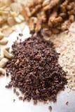 Raw cacao, sliced almonds, walnut, cashew. Assortments of Nuts: raw cacao, sliced almonds, walnut, cashew Royalty Free Stock Photo