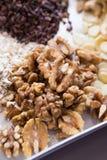 Raw cacao, sliced almonds, walnut, cashew. Assortments of Nuts: raw cacao, sliced almonds, walnut, cashew Stock Photo