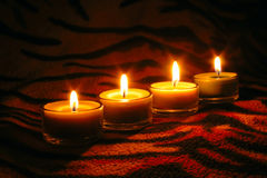 Raw candles on striped surface Stock Photo