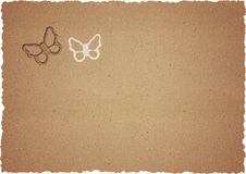 Raw cardboard with butterflies Stock Photography