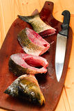 Raw carp fish  on a wooden board Stock Photo