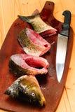 Raw carp fish  on a wooden board Stock Photo