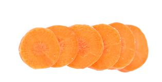 Raw carrot slices on a white background Stock Image