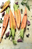 Raw carrots on a baking tray for roasting Royalty Free Stock Image