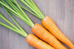 Raw carrots with green tops Royalty Free Stock Photos