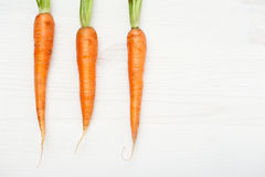 Raw carrots on white wooden table Royalty Free Stock Photography