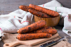 Raw carrots on a wooden board Stock Photo
