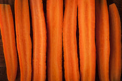 Raw carrots on the wooden table Royalty Free Stock Photo
