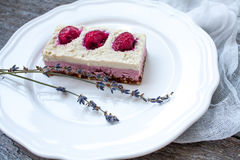 Raw cashew cake cheesecake and berries strawberries, cherries royalty free stock image
