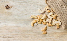 Raw cashew nuts pour from sack Royalty Free Stock Images