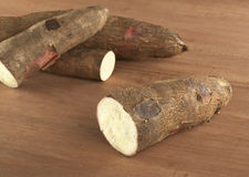Raw Cassava on Wood Stock Photos