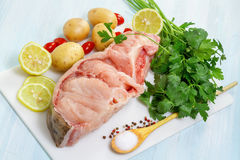 Raw Catfish with herbs and spices. On table Stock Photos