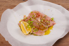 Raw Catfish with herbs and spices Stock Photos