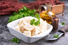 Raw cauliflower. In bowl and on a table Royalty Free Stock Image