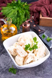 Raw cauliflower. In bowl and on a table Royalty Free Stock Photography