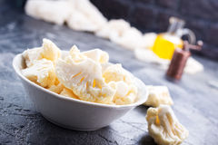 Raw cauliflower. In bowl and on a table Stock Image