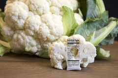 Raw cauliflower head and floret with nutritional fact label on w Royalty Free Stock Photo