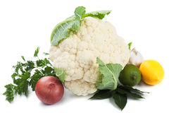 Raw cauliflower isolated on white. Raw cauliflower with herbs and vegetables isolated on white background Royalty Free Stock Photos