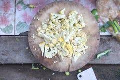 Raw cauliflower sliced. On chopping board Royalty Free Stock Photo