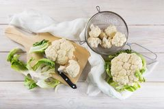 Raw cauliflower on the table of the kitchen Royalty Free Stock Image