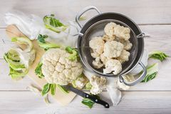 Raw cauliflower on the table of the kitchen Stock Photo